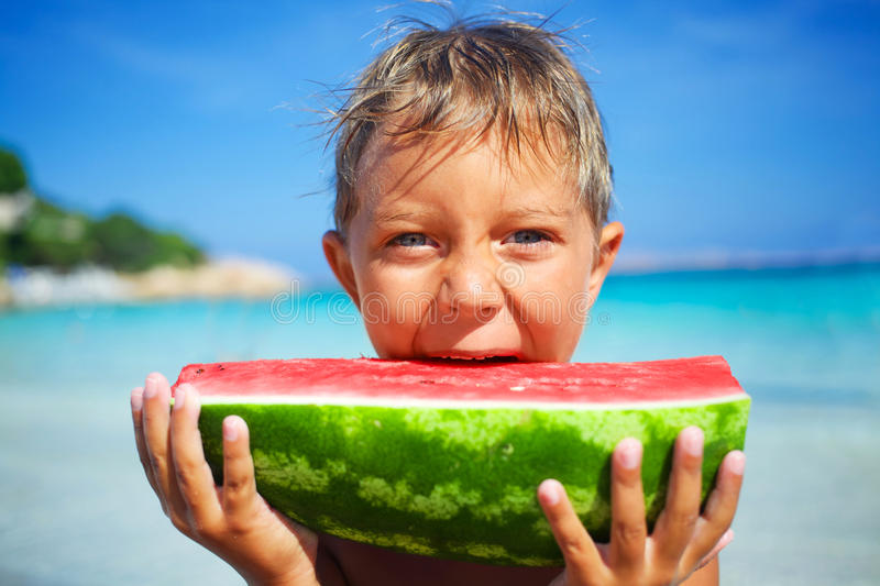 Child with watermelon royalty free stock image