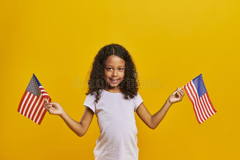 Child waving American flags. African girl waving American flags stock images