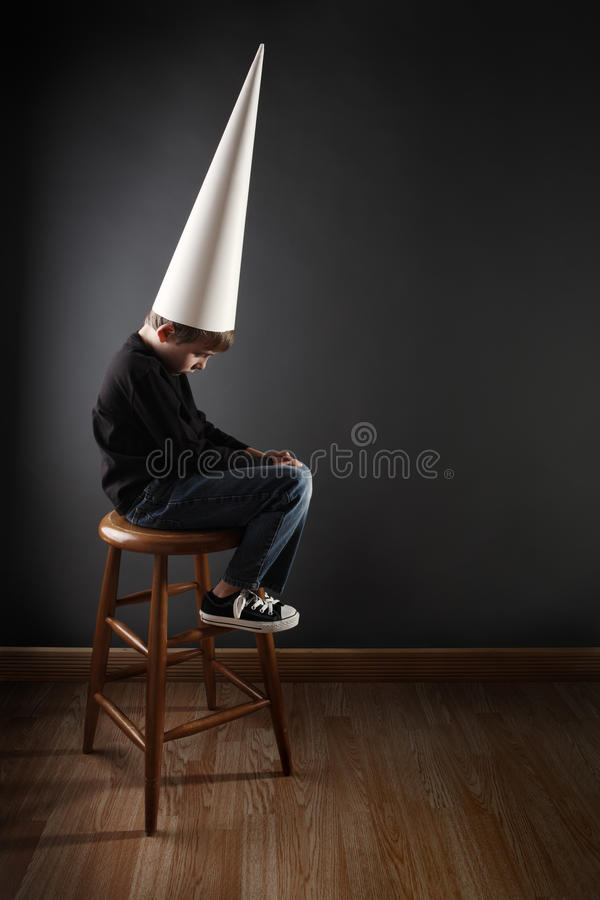 Download Child Wearing A Dunce Cap Stock Photography - Image: 17769572