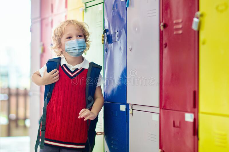 Child wearing face mask. Virus outbreak stock images