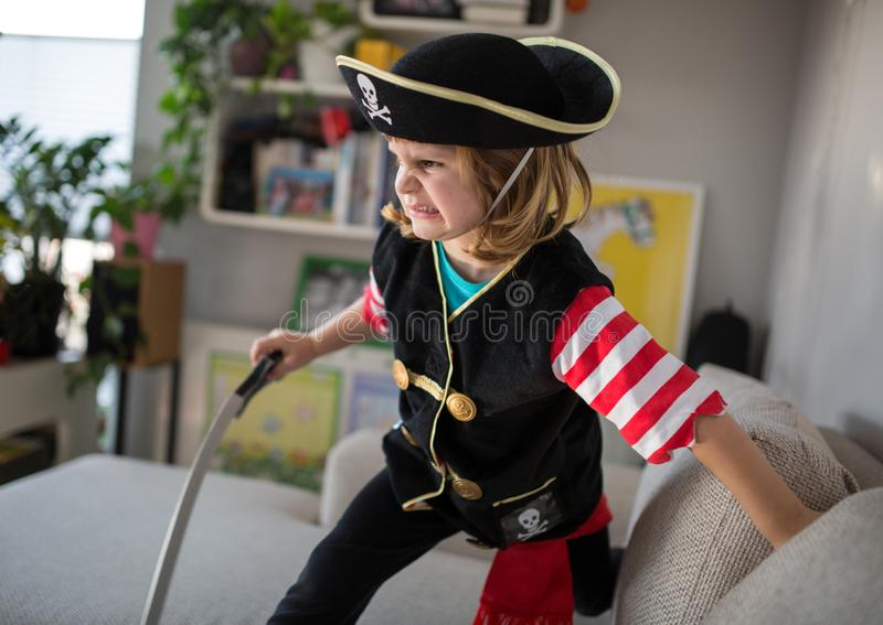 Child wearing pirate costume royalty free stock photography