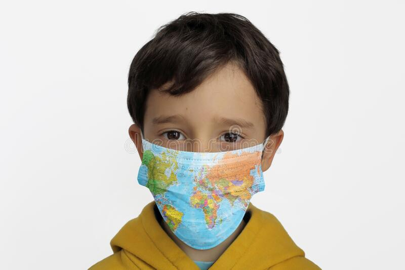 A child wearing protection mask stock photo