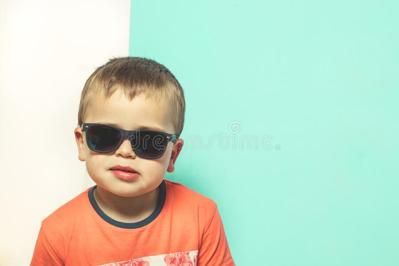Child wearing sunglasses with a serious attitude stock image