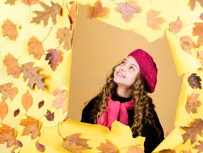Child wearing warm coat or jacket fallen leaves background. Autumn outfit. Enjoy autumn day. Fashion store shop. Buy royalty free stock images