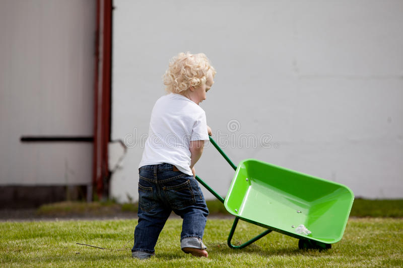 Child with Wheelbarrow royalty free stock photos
