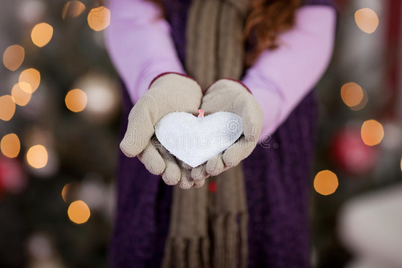 Child with white Christmas heart stock photography