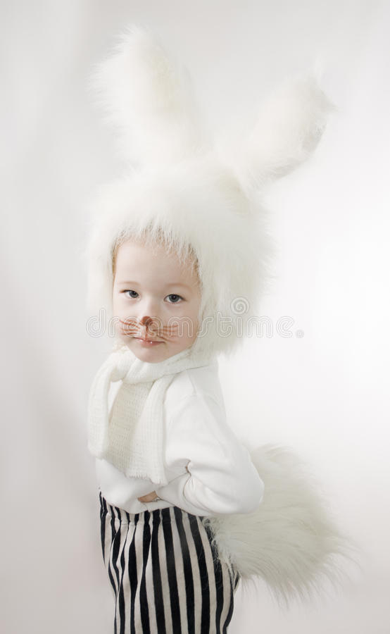 Child In A White Downy Bunny Costume. Royalty Free Stock Photo