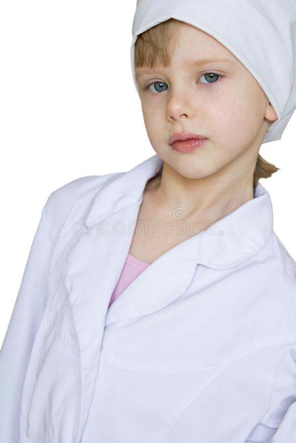 Child in a white medical robe. Child in a white medical white robe royalty free stock photography