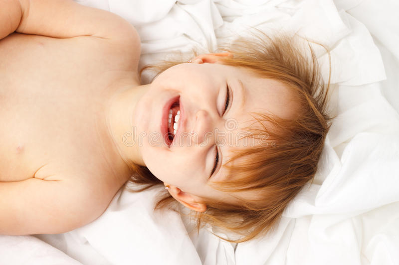 Child White Sheet Laugh Lay stock photo