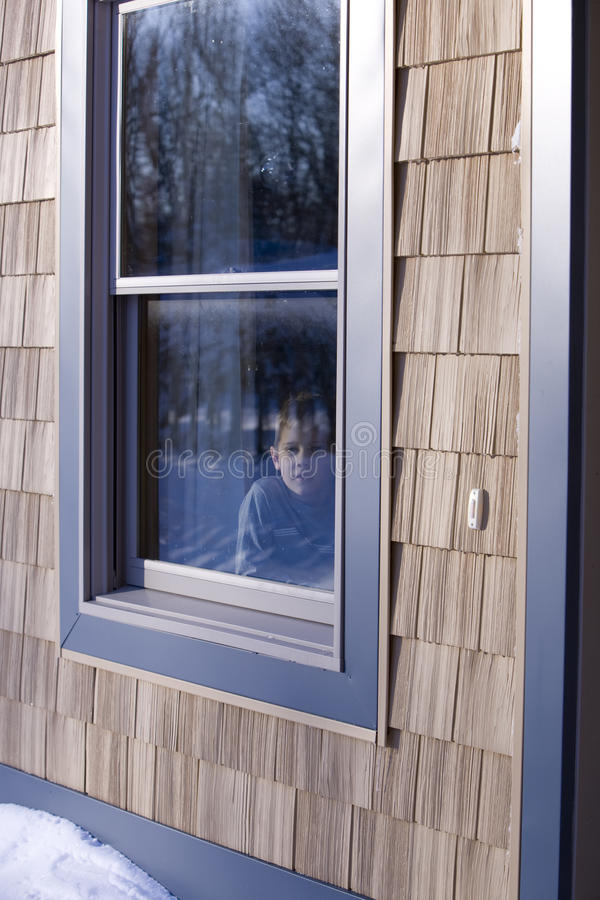 Child in a window stock photography