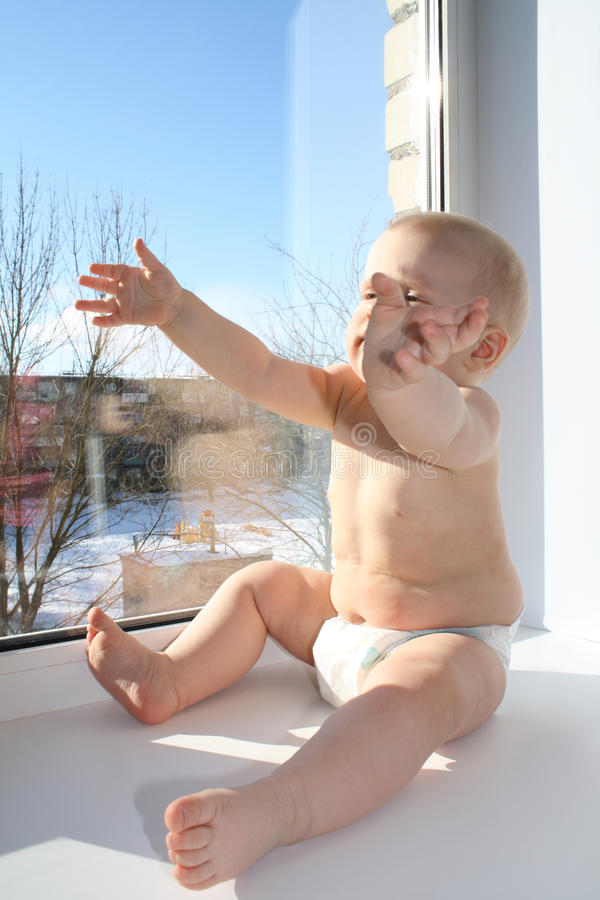 The Child On A Window Sill Royalty Free Stock Images