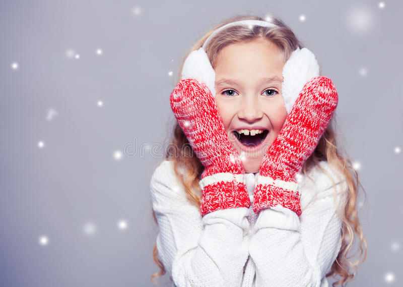 Child in winter clothes royalty free stock image
