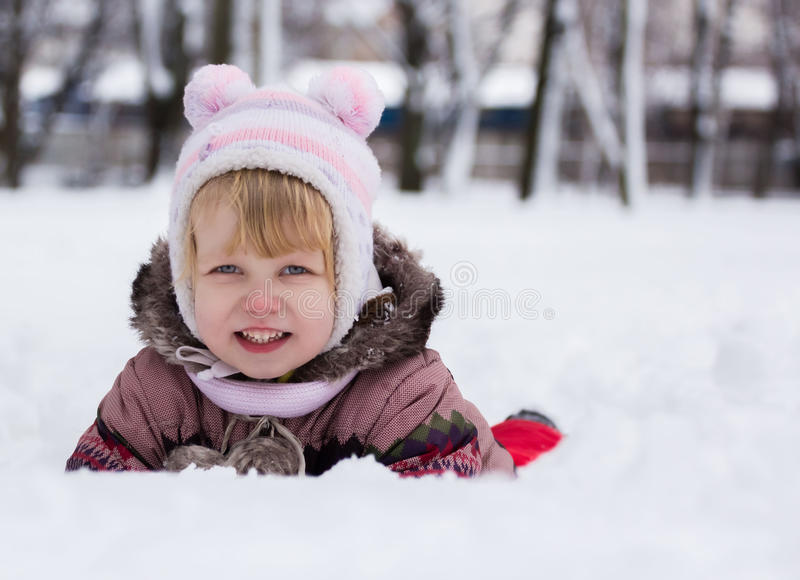 Child in winter. Happy girl on snow royalty free stock photos