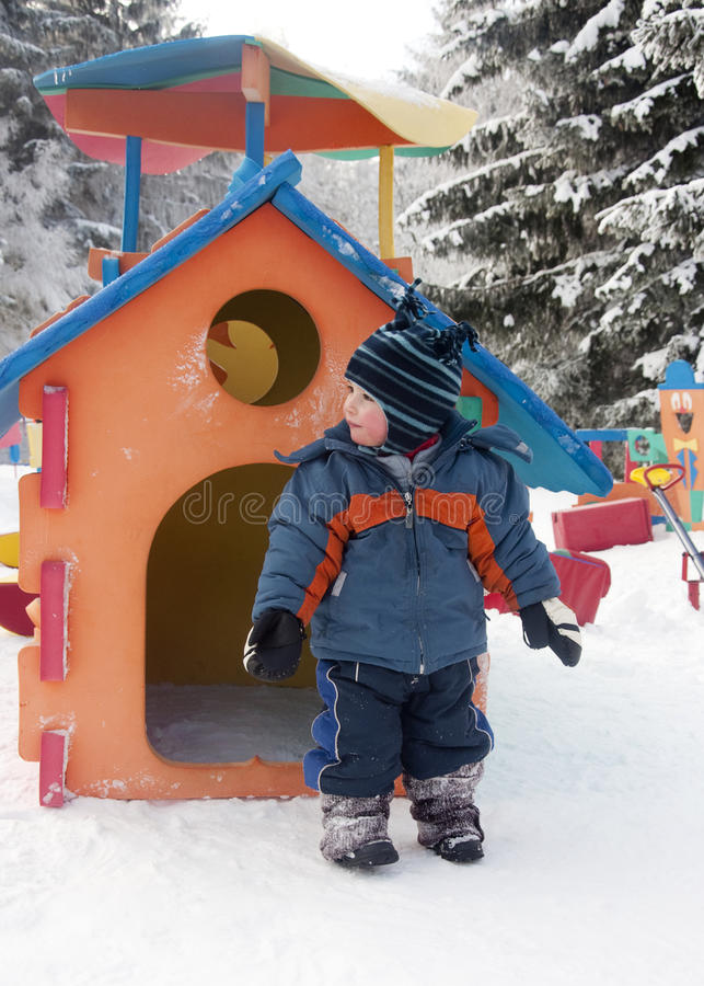 Child In A Winter Playground Stock Image