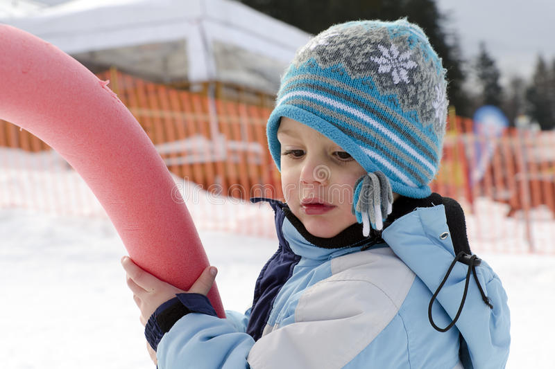 Child in winter playground royalty free stock photos