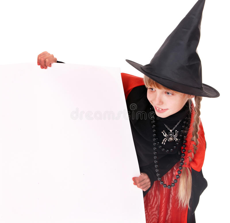 Child witch holding banner . royalty free stock image