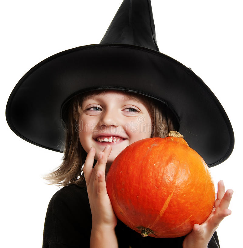 Download Child - witch with pumpkin stock image. Image of black - 26613007