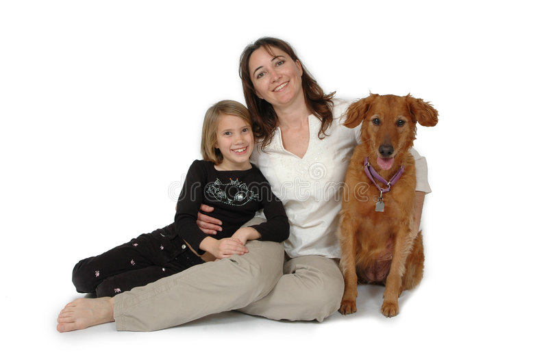 Child, Woman and Dog. Woman and Child taking pictures with a Golden Retriever