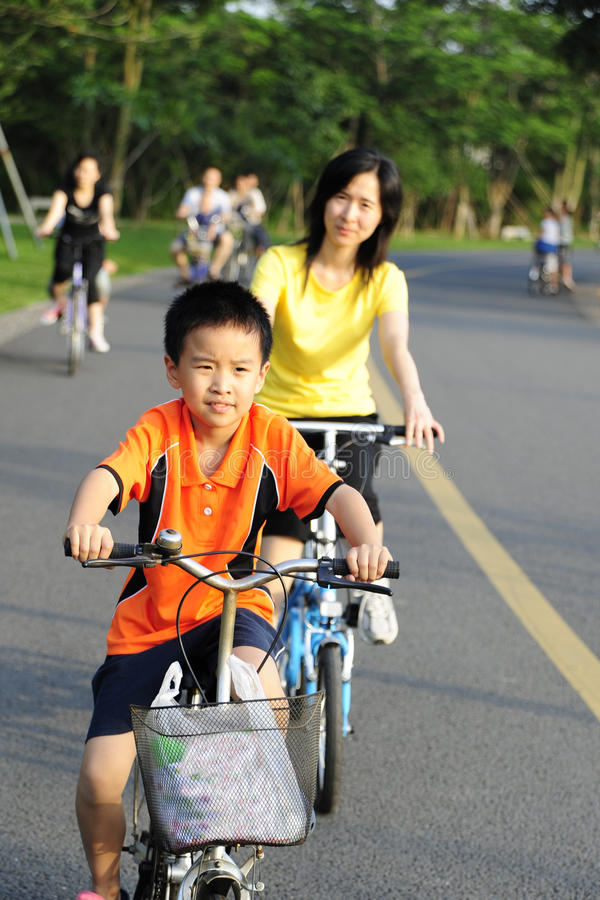 A child and a women cycling royalty free stock photos
