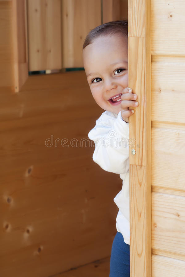 Child at wooden door royalty free stock photo