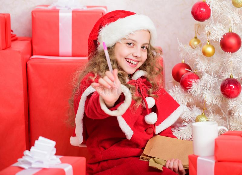 Child write letter to santa claus. Child santa costume believe in miracle. Letter for santa. Wish list. I was good girl stock images