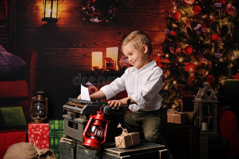 The child writes a llist to Santa Claus royalty free stock images