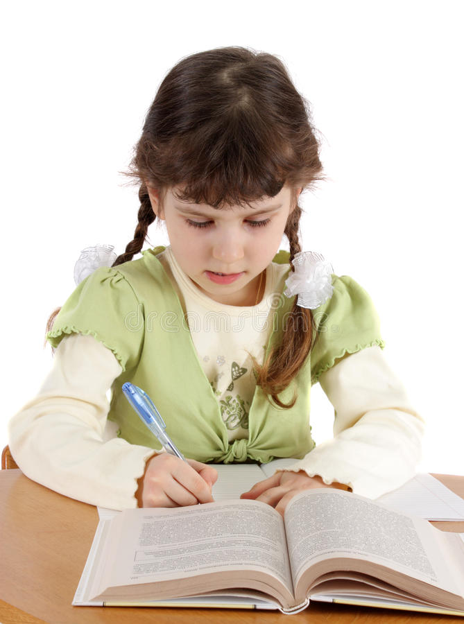 Download Child Writes And Reads. Stock Images - Image: 12897164