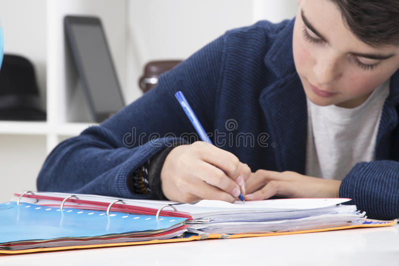 Child writing. In the book at school stock photo