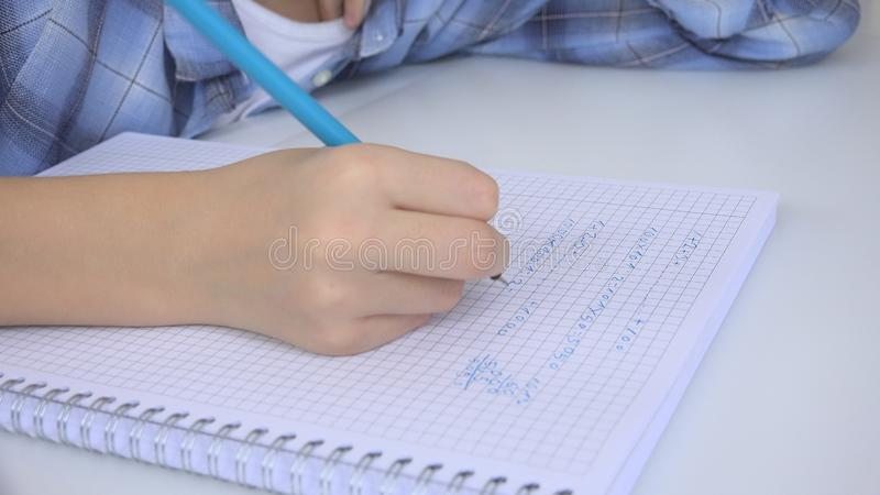 Child Writing in Classroom, Studying, Kid Homework, Student Learning Mathematics.  stock photo