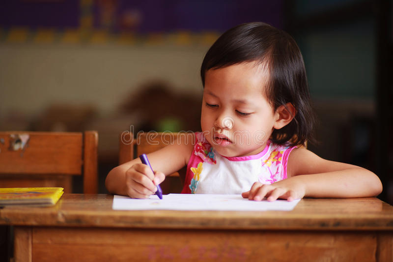 Child writing. Child intend to writing in the classroom stock images