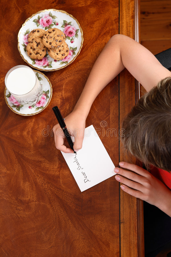 Child writing a letter royalty free stock photo