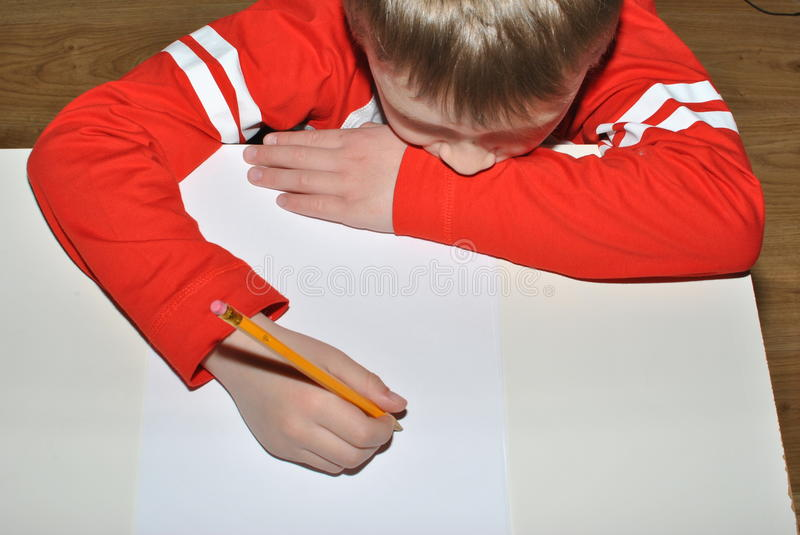 Child writing with pencil. Small hand writing with pencil stock image