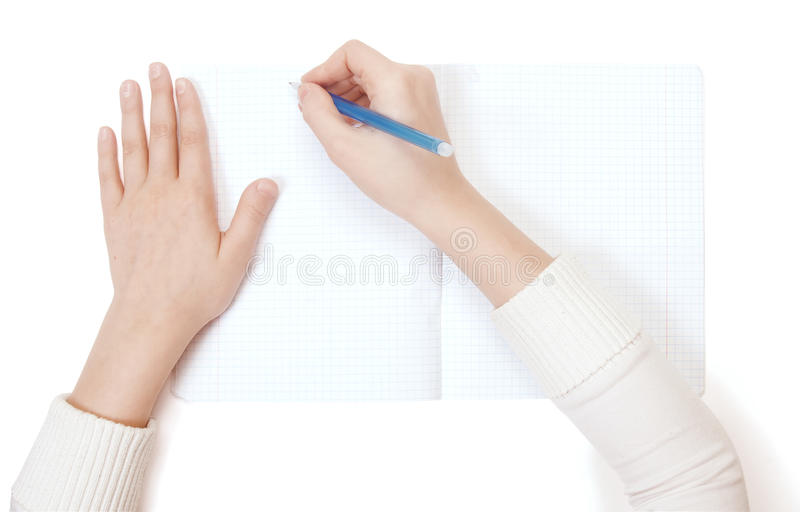 A child writing. A child write in writing-book stock photo