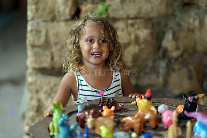 Child of 3-4 years old plays with toys in Chania royalty free stock photos