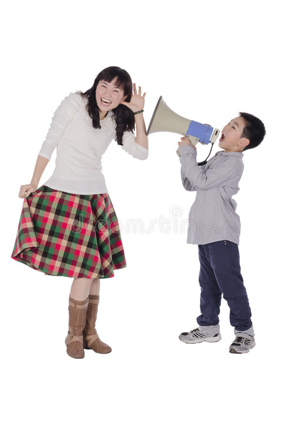 Child yell at mother with megaphone stock images