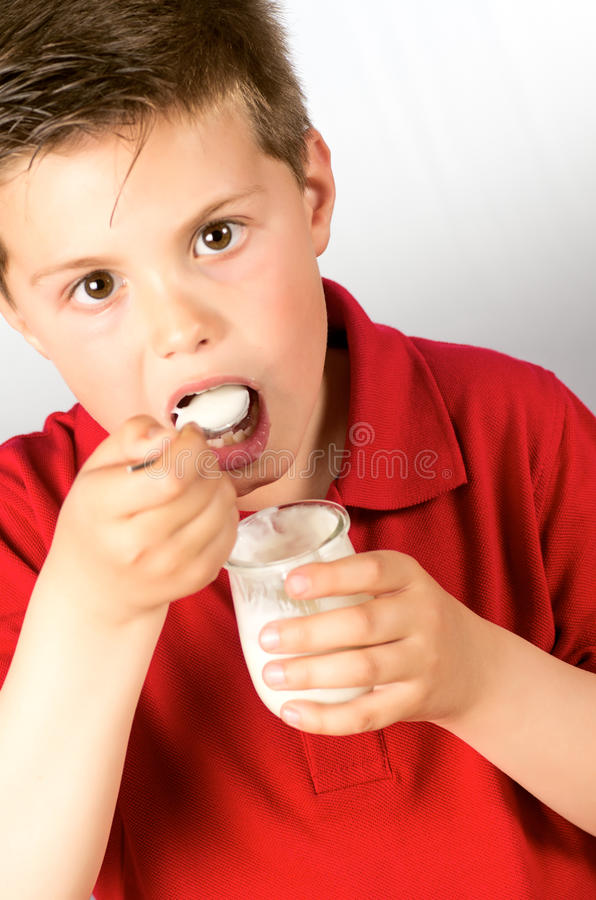Download The child of yogurt 4 stock photo. Image of people, face - 30387266