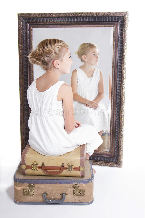 Child or young girl in front of a mirror royalty free stock photo