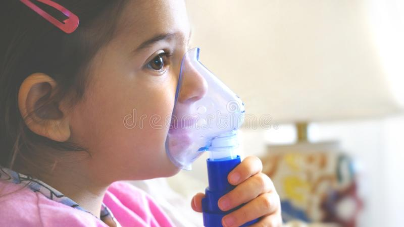 Childhood asthma inhaling mask illnesses little baby girl with flu id doing aerosol independently royalty free stock photography