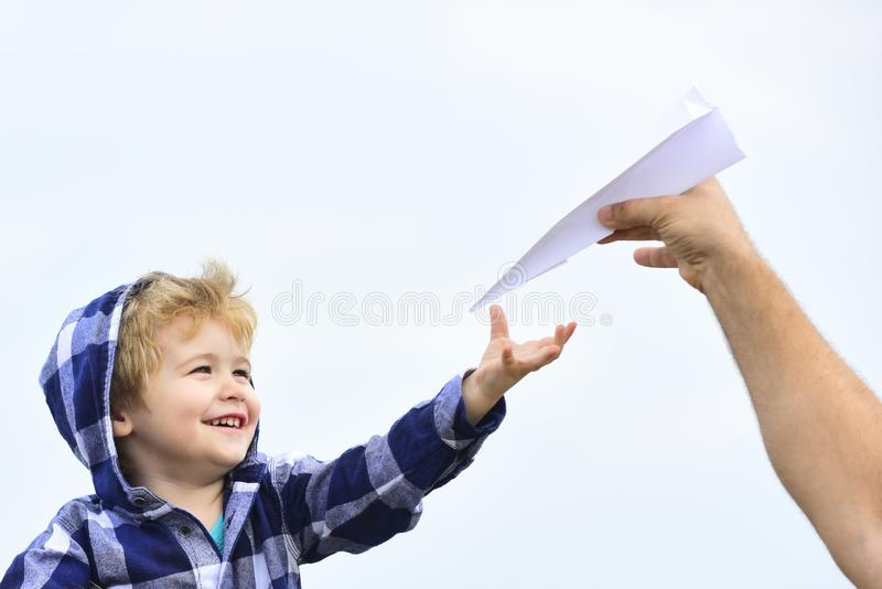 Childhood. Child son playing with paper airplane. Carefree. Freedom to Dream - Joyful Boy Playing With Paper Airplane. Childhood. Child son playing with paper royalty free stock photos