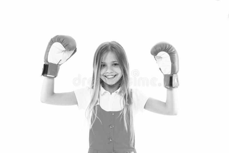 Childhood and childcare. Kid athlete show power. Happy child in boxing gloves isolated on white. Little girl smile. Before training or workout. Sport activity stock photo
