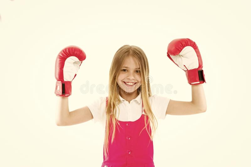 Childhood and childcare. Kid athlete show power. Happy child in boxing gloves isolated on white. Little girl smile. Before training or workout. Sport activity stock image