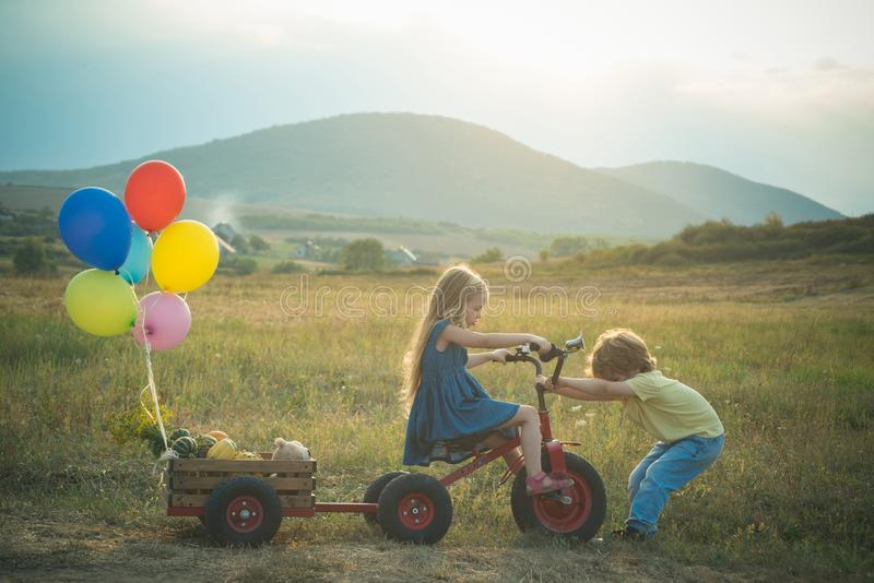 Childhood concept. American farm life. Springtime on the ranch. Two young farmers. Childhood on countryside. Active royalty free stock images