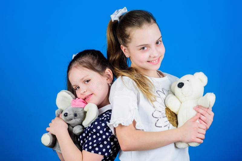 Childhood concept. Kids adorable cute girls play with soft toys. Happy childhood. Child care. Excellence in early. Childhood education. Sisters or best friends stock photos