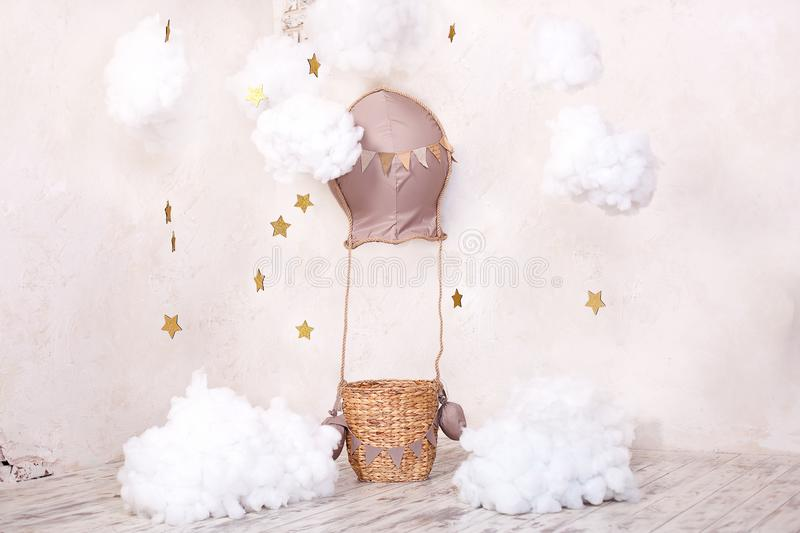 Childhood dreams. Stylish vintage children`s room with aerostat, balloons and textile clouds. Children`s location for a photoshoot. Aerostat, balloon and stock images