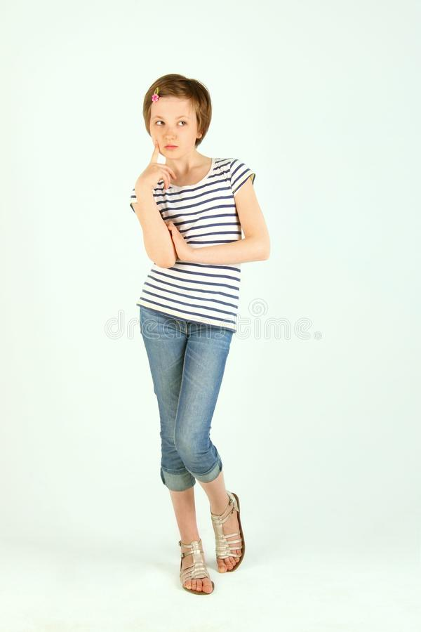 A Cute Girl Looking Thoughtful With Her Finger To Her Mouth stock photos