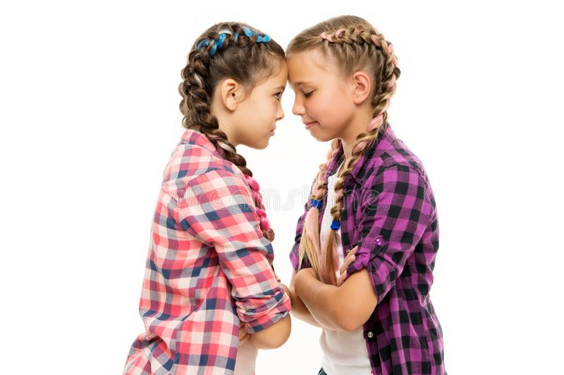Childhood friends. Little friends isolated on white. Small friends wear long plait hair. Beauty look of adorable girls. Friends and friendship royalty free stock image