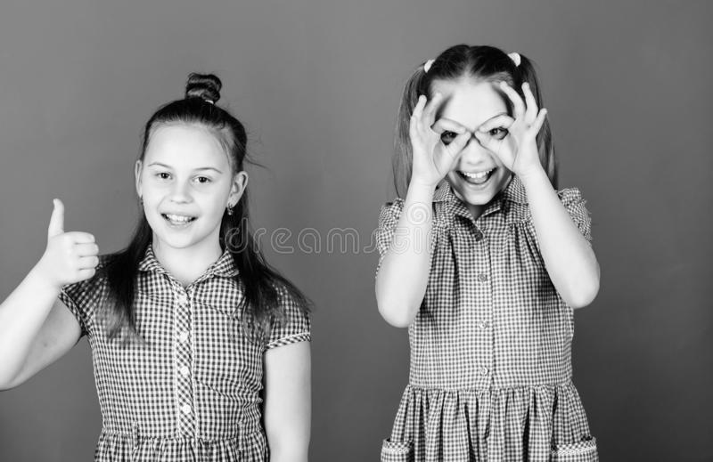 Childhood is a fun time. Happy little girls having fun together. Small children gesturing and making funny faces for fun royalty free stock photo