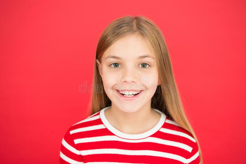 Childhood happiness. family and love. childrens day. Good parenting. Child care. small girl child. School education. Happy little girl on red background stock photo