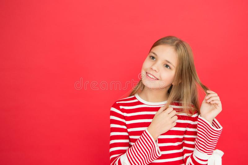 Childhood happiness. family and love. childrens day. Good parenting. Child care. small girl child. School education. Happy little girl on red background. copy royalty free stock photo