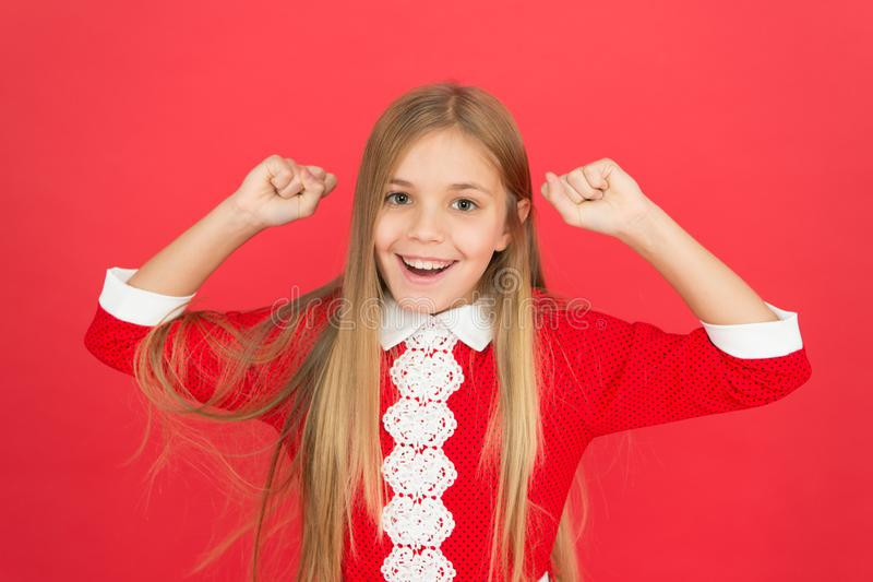 Childhood happiness. happy little girl on red background. small girl child. School education. family and love. childrens. Day. Good parenting. Child care stock photo
